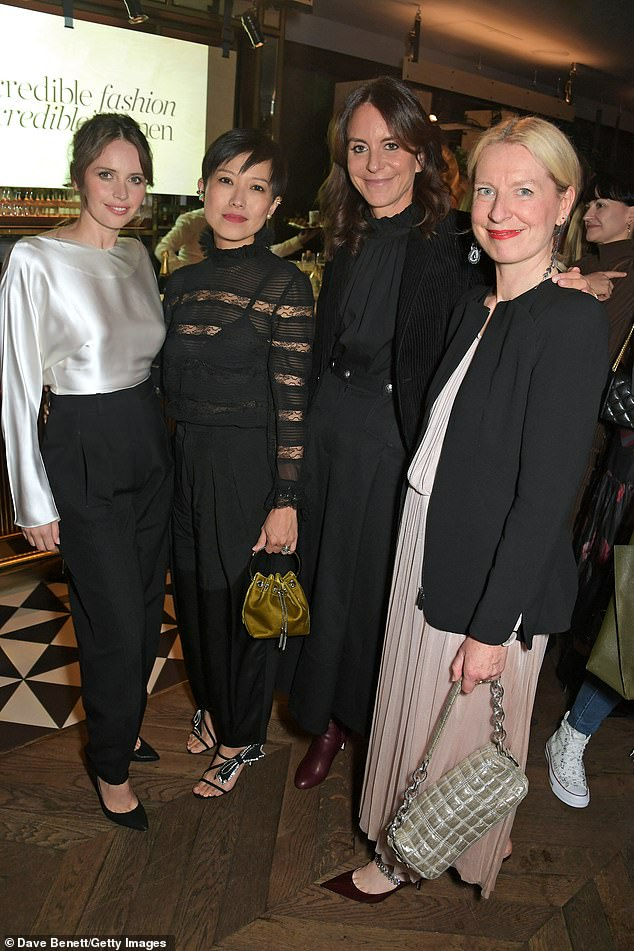 Glam: She boosted her height in a pair of towering black heels as she posed alongside L-R:Sandra Choi, President of NET-A-PORTER and MR PORTER Alison Loehnis and Sarah Bailey