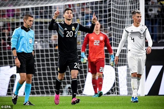 Alario celebrates after finding a way back into the contest for his Argentina team-mates