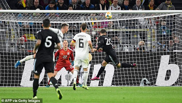 Lucas Alario directs a glancing header beyond Germany's Marc-Andre ter Stegen