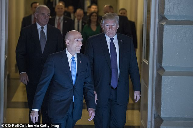 Paul Irving (left) is the House sergeant at arms and is the chief law enforcement office in the House; he also escorts high-profile guests, like he does above with President Trump in November 2017, when they visit the Capitol