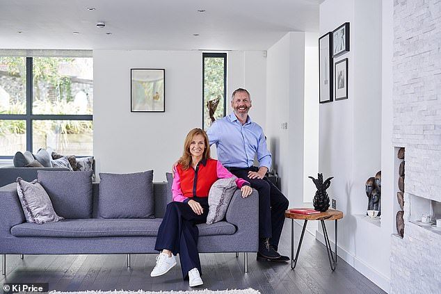 Pictured together at their home in Guildford, Surrey, this month. They married when their son Conrad was three years old