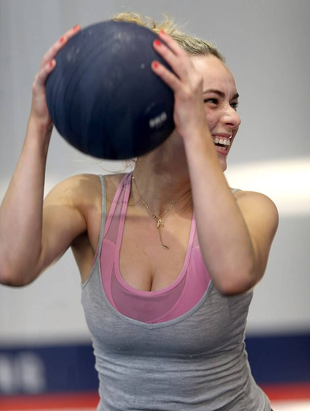 Say cheese: Abbie was all smiles when she took all of her pent-up anger out on a series of  medicine ball slams