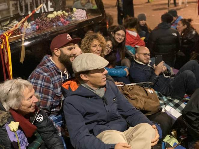 Sherlock star Cumberbatch poses for a photograph with the protesters last night who are camped at Trafalgar Square