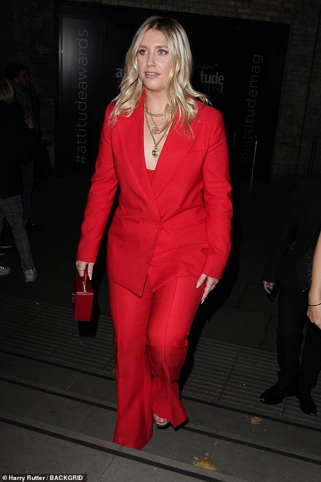 Lady in red: Hot on her heels what X Factor beauty Ella, who looks stunning in a red suit with a plunging bustier worn underneath to boost the sex appeal