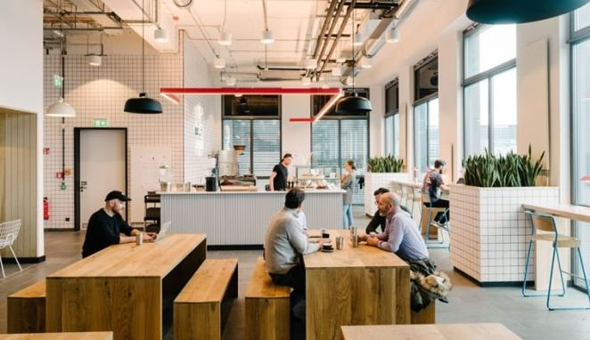 The eating area in WeWork's Friedrichshain office is also Instagram worthy with a funky canteen look to it - with drop down lighting and a rustic feel