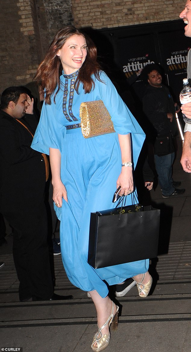 Feeling blue? Sophie Ellis-Bextor opted for a Seventhies-inspired number with a billowing kaftan shape and gold adornments