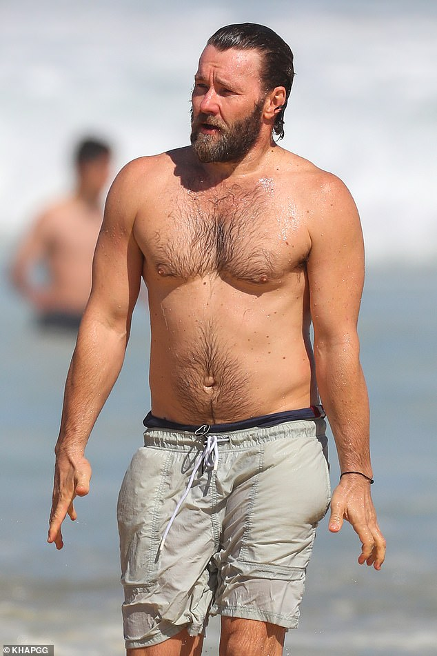 Cooling off: Despite what has undoubtedly been a gruelling promotional schedule, the talented star made time for a quick swim at the beach