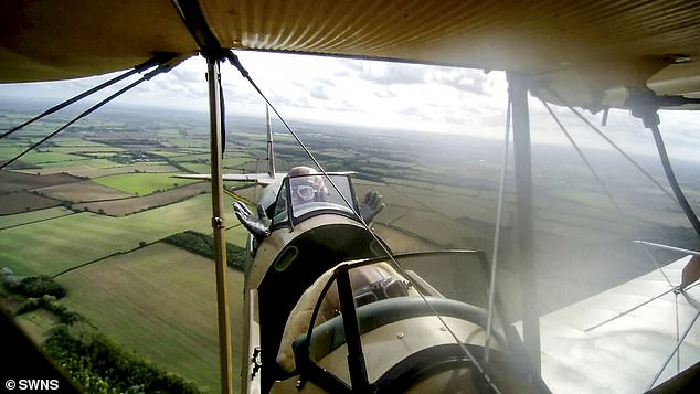 Spike didn't appear to be afraid while flying the Tiger Moth and said he had experienced more daunting bus rides