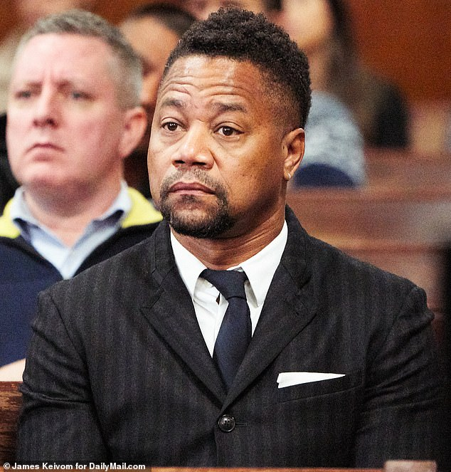 Cuba Gooding Jr. raises his eyebrows as he sits in court on Thursday. He had shown up for his forcible touching trial but was hit with new charges in a sealed, grand jury indictment