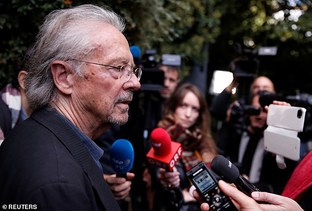 Austrian author Peter Handke addresses the media, following the announcement he won the 2019 Nobel Prize in Literature, in Chaville, near Paris, France October 10.  Favourites, such as the Handmaid's Tale author Margaret Atwood and Haruki Murakami, were snubbed