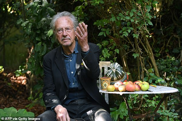 Austrian writer Peter Handke poses in Chaville, in the Paris surburbs, on October 10, 2019 after he was awarded with the 2019 Nobel Literature Prize