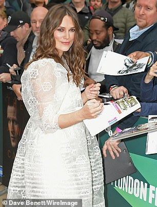Babe: Keira flashed a smile as she signed autographs