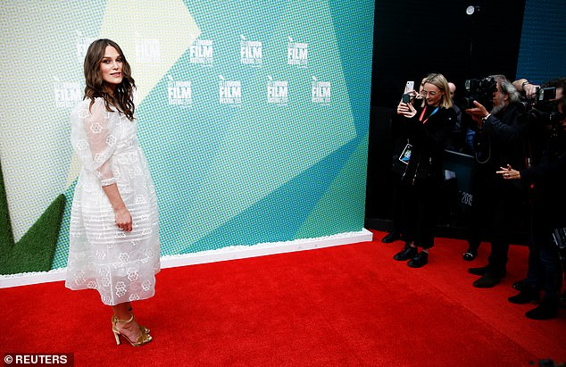 Keira stunned in the figure-skimming number which put emphasis on her tiny waist which fell at an ankle-grazing length