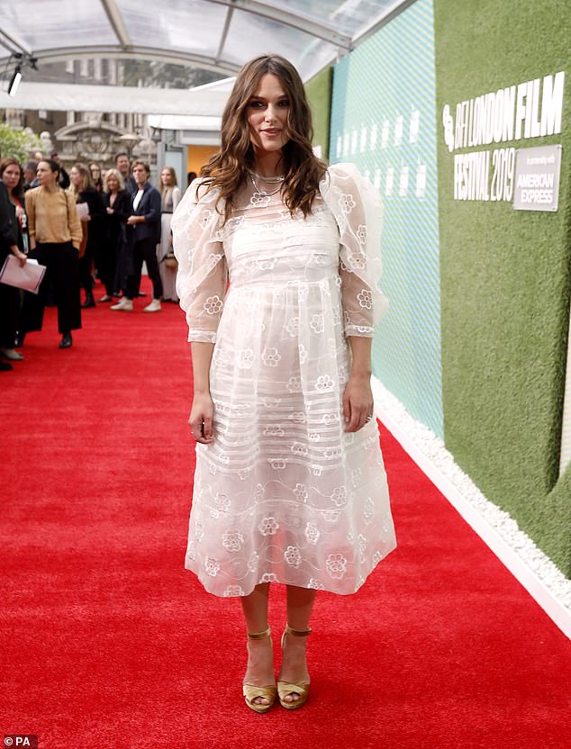 The actress proved to be absolutely perfect in a whimsical white mididress with a sensational white lace overlay