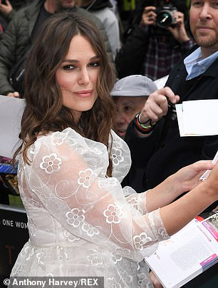 Beauty: The British beauty showed off her striking features with a glamorous coat of make-up, which complemented her tousled wavy brunette locks