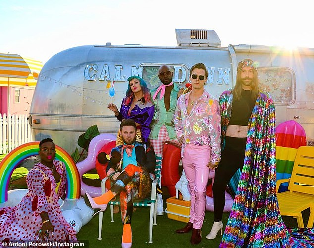 Dressed to thrill in glittering threads and vibrant colors, Jonathan was joined by his reality crew incuding Antoni Porowski, Karamo Brown, Bobby Berk and Tan France for Taylor's You Need To Calm Down video