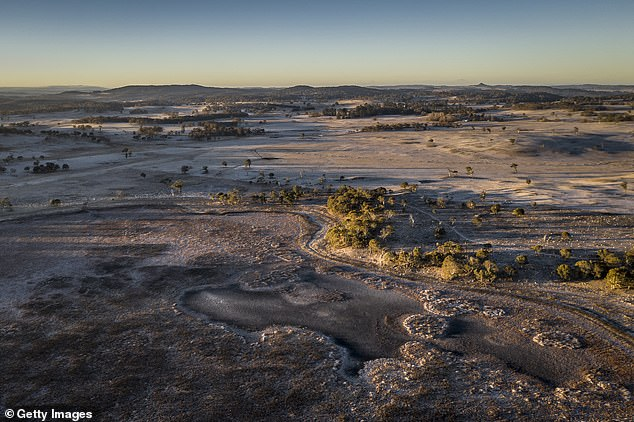 Last year, the period 2019-2021 was predicted to be very likely the driest period in the Australian climate for over 200 years (pictured drought-ravaged land near Guyra, north-eastern New South Wales, which once held a full lagoon in the foreground)