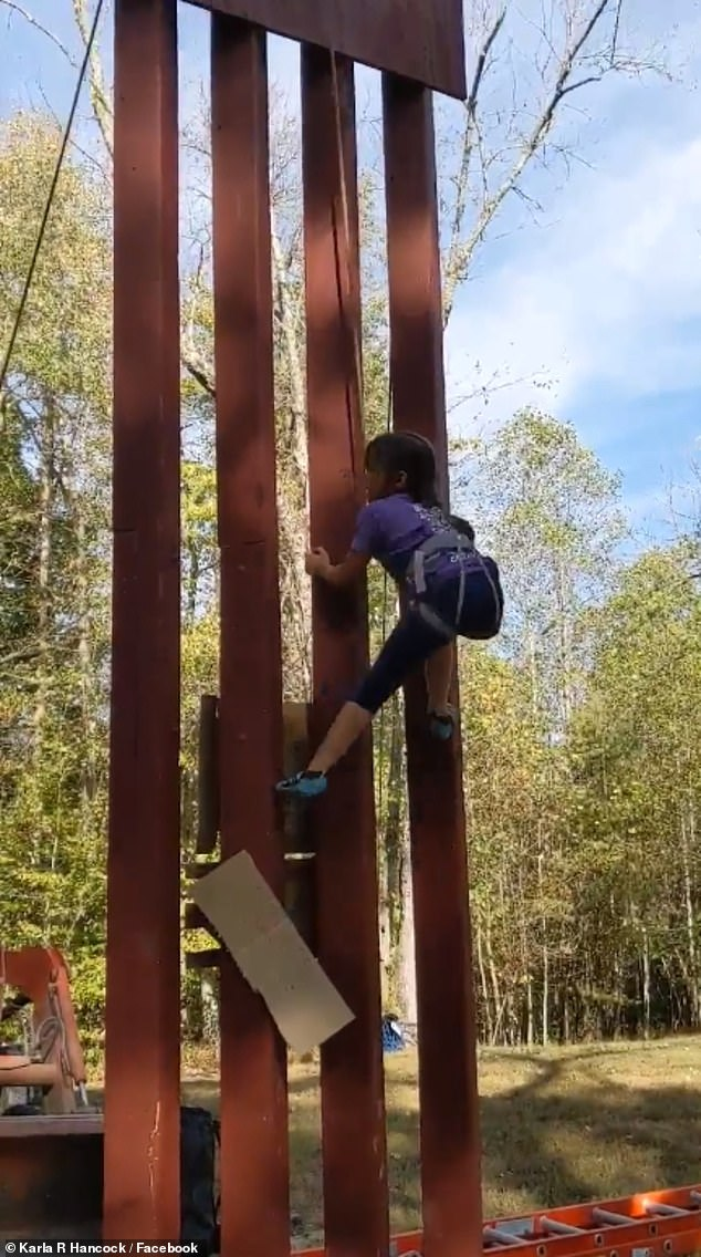 8-year-old Lucy Hancock (pictured) scaled an 18-foot-replica of President Donald Trump's southern border wall under a minute