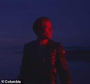 Dazzling: Harry wore a glittering black blazer