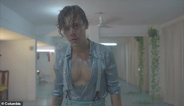 Hunk: The singer showed off his glistening torso throughout the video in revealing attire