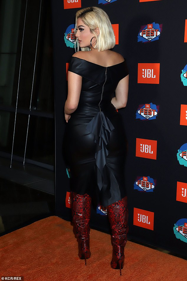 Statement: The singer's statement dress featured a black ruffle and a silver zip down the back