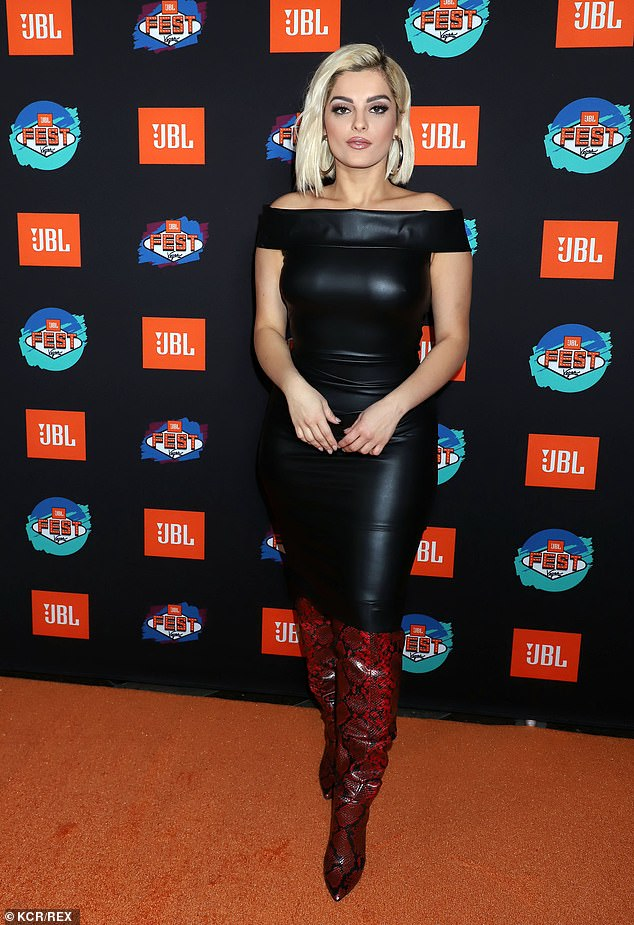Stunning: Bebe Rexha, 30, looked sensational in a skin tight black leather dress and red snake skin print boots atJewel Nightclub in Las Vegas on Thursday night