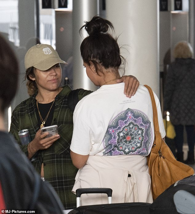 New couple: Chelcee donned a Route 66 cap after the trip to LA and the pair looked besotted with each other