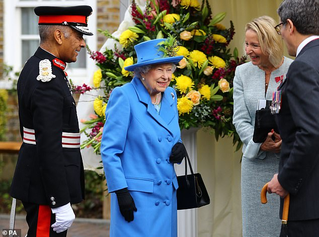 The Queen looked radiant all in blue today as she arrived in South London to officially open a new housing development for armed forces veterans