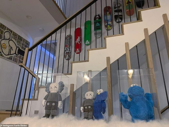 U Smile:Another photo showed the star's collection of Sesame Street collectibles, with Cookie Monster toys placed in glass cases atop a fluffy rug