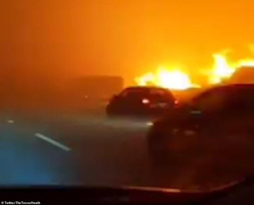 In one of the videos the driving conditions become so bad due to the smoke that cars begin to pull over on the side of the road (pictured) on Thursday night
