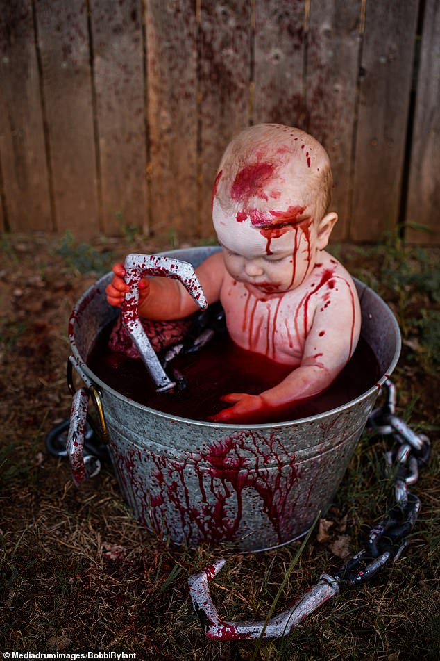 The photographer revealed that many people didn't like the photos of her children, including this one of her son Kamden, in a fake blood bath