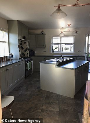 The grandmother used two licks of a cool grey paint tto update her kitchen units