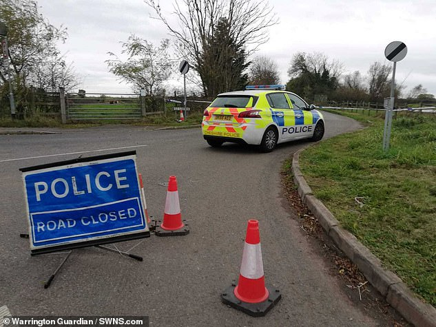A police cordon is pictured blocking off the scene with a cordon and police car last November