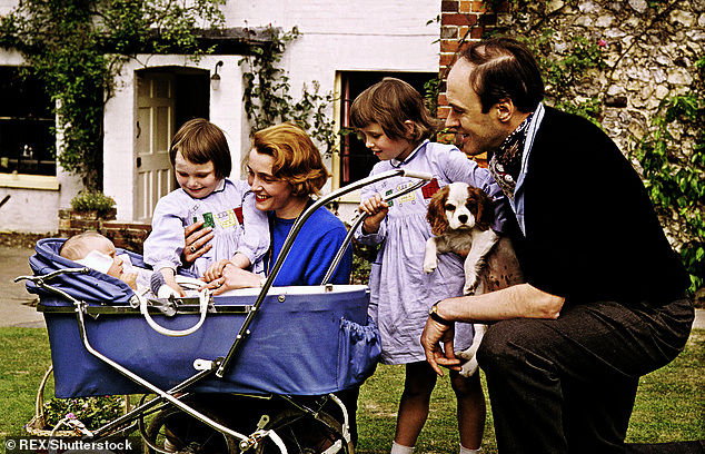 Roald Dahl with wife Patricia Neal and their children Theo (in the pram), Tessa (next to Patricia) and Olivia (next to Roald) at their home White Fields in Great Missenden, Buckinghamshire, in 1962