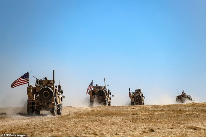 A US military convoy is photographed in a joint patrol with Turkish troops in al-Hashisha, a suburb of Tal Abyad, in September. The United States is slowly withdrawing troops from the region