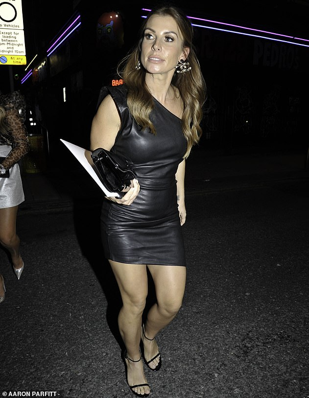 Looking good:She teamed her sexy frock with a pair of barely-there black heels, which boosted her petite frame as she strutted into the star-studded bash