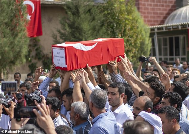 Turkey has said it intends to go 19 miles into Syria to push back Kurdish forces. Pictured: Mourners at funeral of a boy killed in Akcakale, Turkey