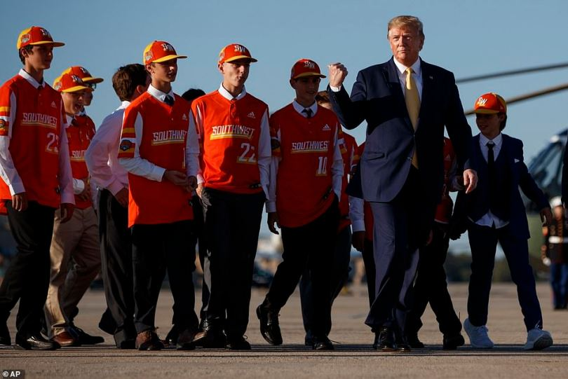 President Donald Trump boards Air Force One with the Little League World Series champions