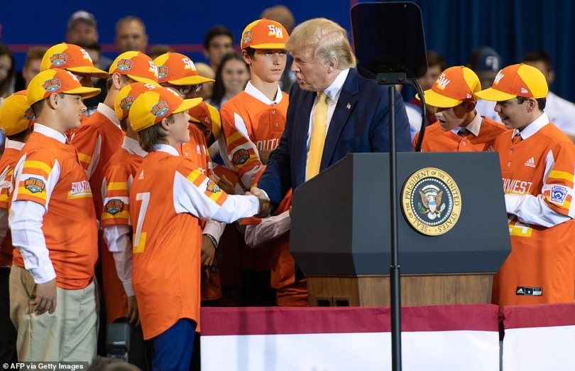 Trump shakes hands with a member of the Little League World Championship baseball team, the Eastbank All Stars