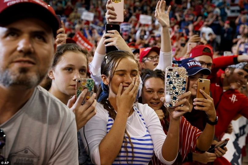 Supporters of President Donald Trump cheer as he arrives to speak during a campaign rally at the Lake Charles Civic Center