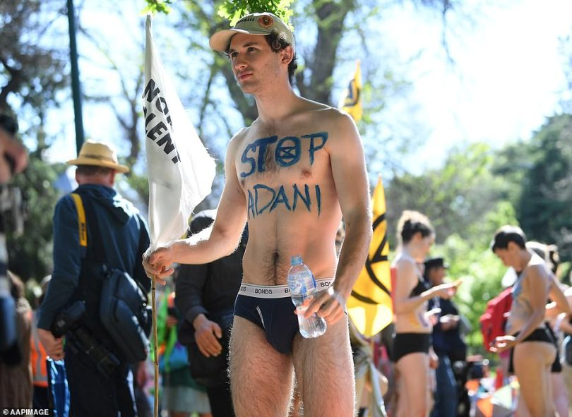 A man stripped to his black underwear was captured holding a Mount Franklin 500ml plastic water bottle
