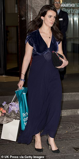 The adjutant leaves the Portrait Gala at the National Portrait Gallery and wears flowers from the event