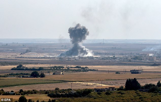 Smoke rises from targets inside Syria during bombing by Turkish forces in Ras al-Ain
