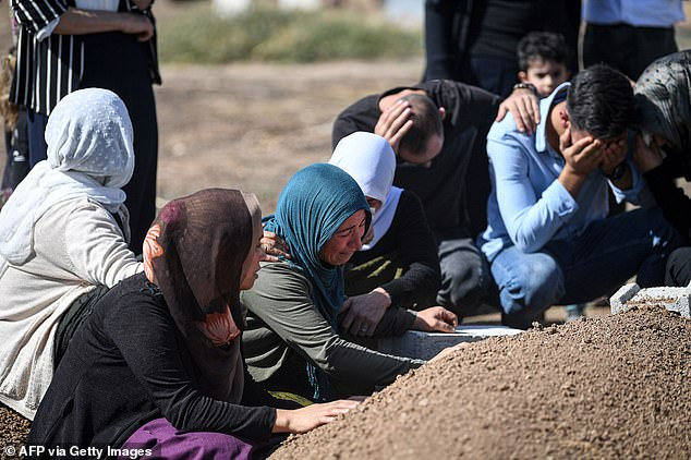 Families in mourning at Yagmur's grave, killed in a mortar attack in Suruc, near the northern border of Syria