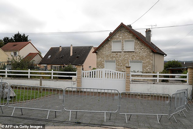 Barriers at the front of a house in Limay, northwest of Paris, reportedly home to the man arrested at Glasgow Airport in late October