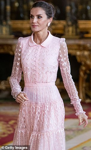 She wore an elegant pink lace collar dress by Felipe Varela with sheer sleeves