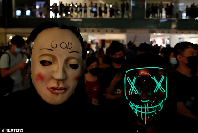 Anti-government protesters wear masks during a demonstration in Hong Kong