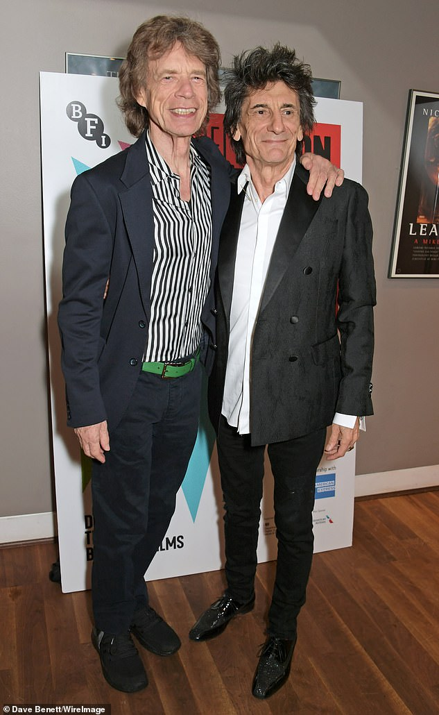 Pals: Meanwhile, Ronnie's The Rolling Stones bandmate Mick Jagger, 76, also turned up to the event to show his support