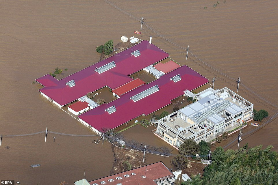 A nursing care home is half submerged by deep flood waters in Kawagoe in theSaitama prefecture around 20 miles north of Tokyo