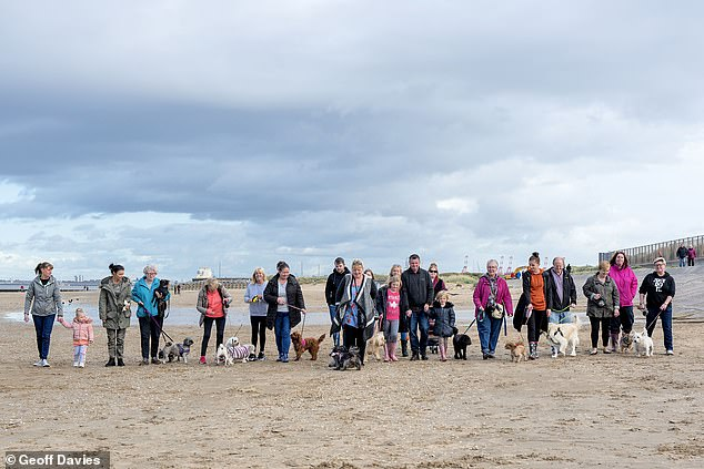 As many as 30 strangers turned up to walk with the pooch, that was going to be put down later that day, along Wallasey beach in Merseyside